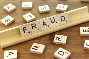 fraud spelt out with scrabble letters